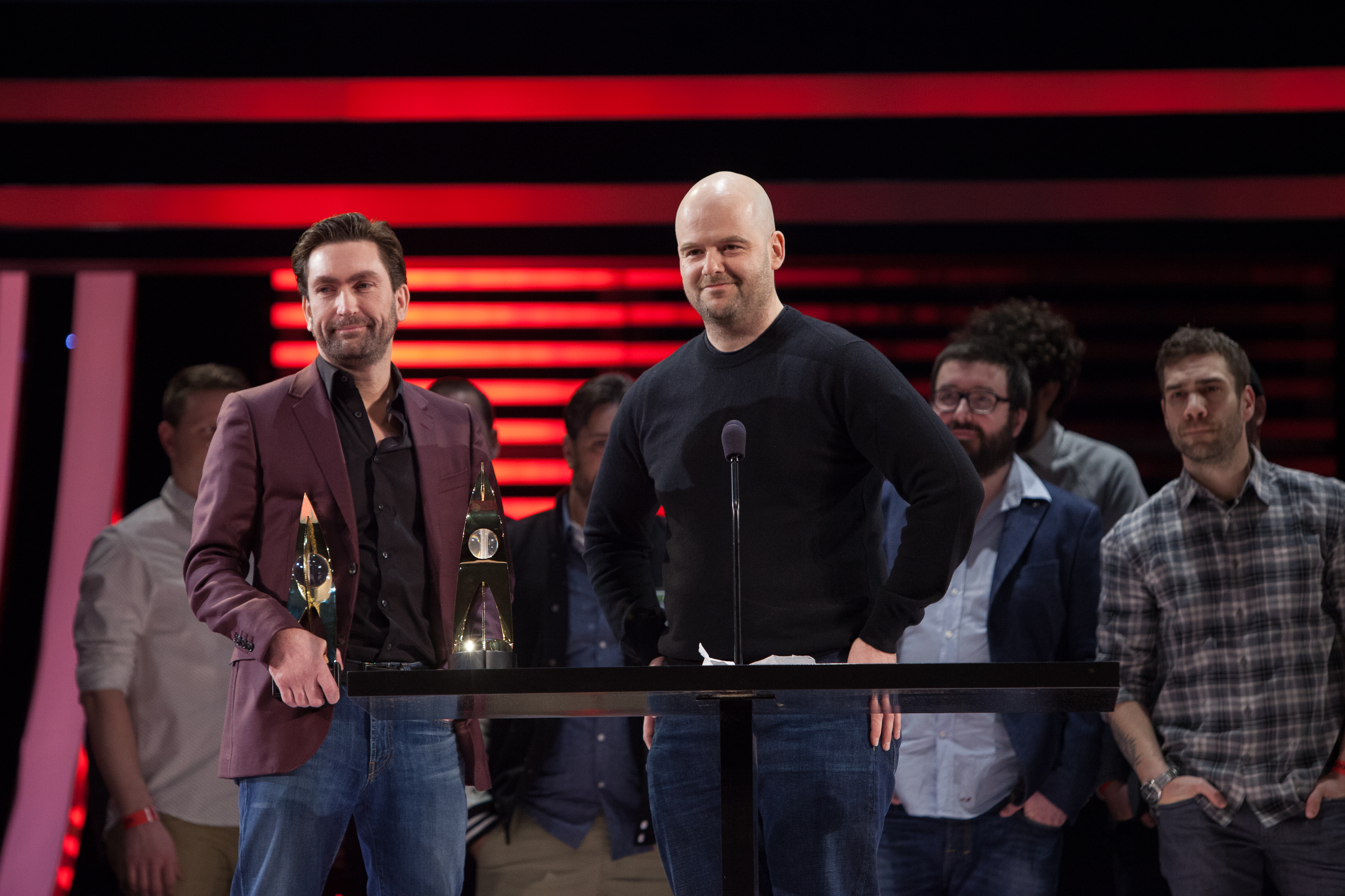 Leslie Benzies and Dan Houser accepting an award.