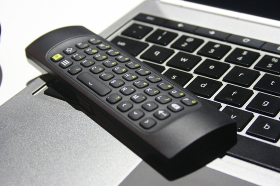 The remote for the Chromebox for meetings. One side has a keyboard. The other has buttons to control the box.