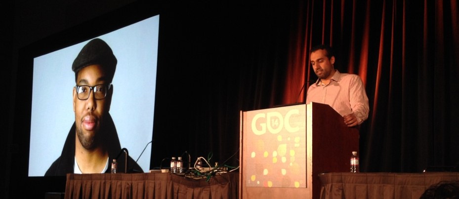 Manveer Heir standing at the podium while he delivers his GDC 2014 panel.