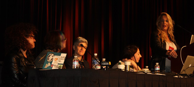 Brenda Romero delivers her opening remarks at the #1ReasonToBe panel at the Game Developers Conference 2014.