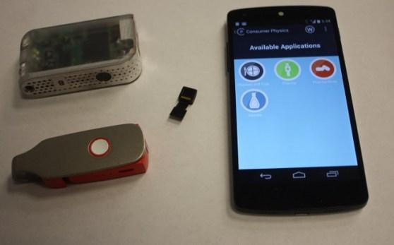 Consumer Physics Scio prototypes with smartphone.