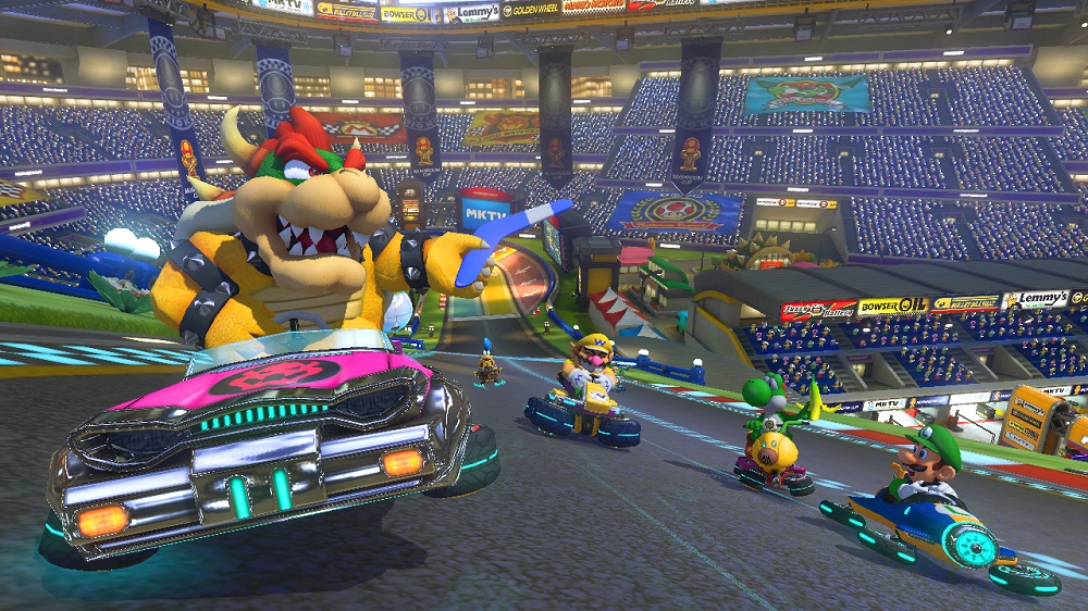 Bowser shows off his blue boomerang, an item new to Mario Kart 8.