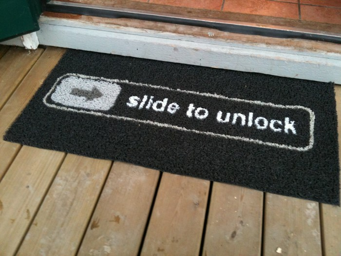 "A ""slide to unlock"" doormat inspired by the iPhone's unlocking mechanism."