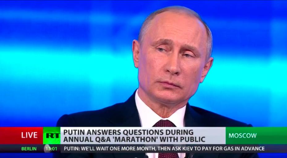 Vladimir Putin, listening yesterday to the translation of Edward Snowden's questions