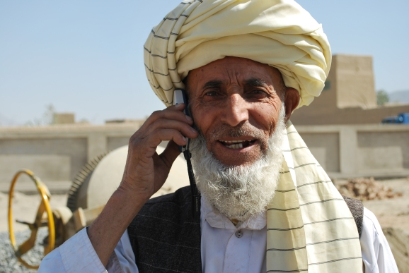 A man on the phone in the Afghani village of Said Ahmad Qazi.