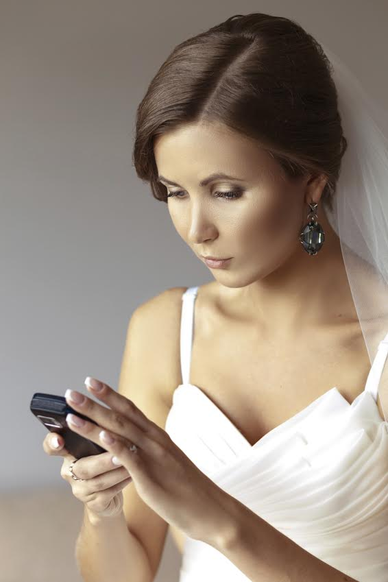 Bride with smartphone