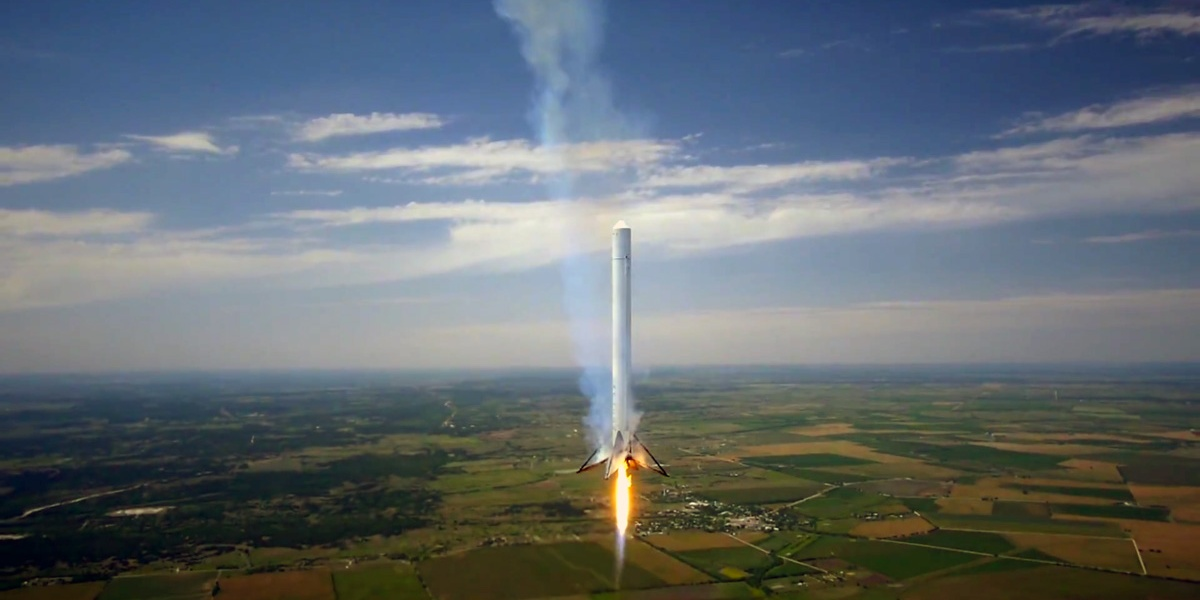SpaceX's Falcon9R rocket hovers above Texas.
