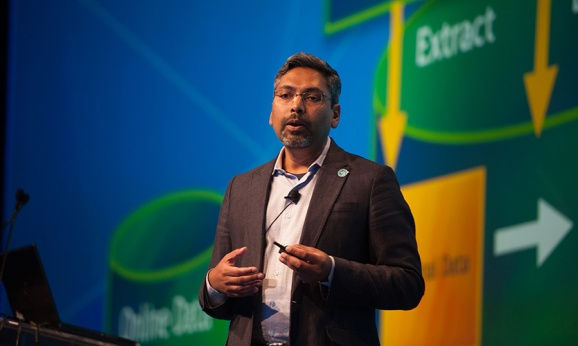 """George Mathew, president and chief operating officer of Alteryx, speaks at the company's """"Inspire"""" user conference."""