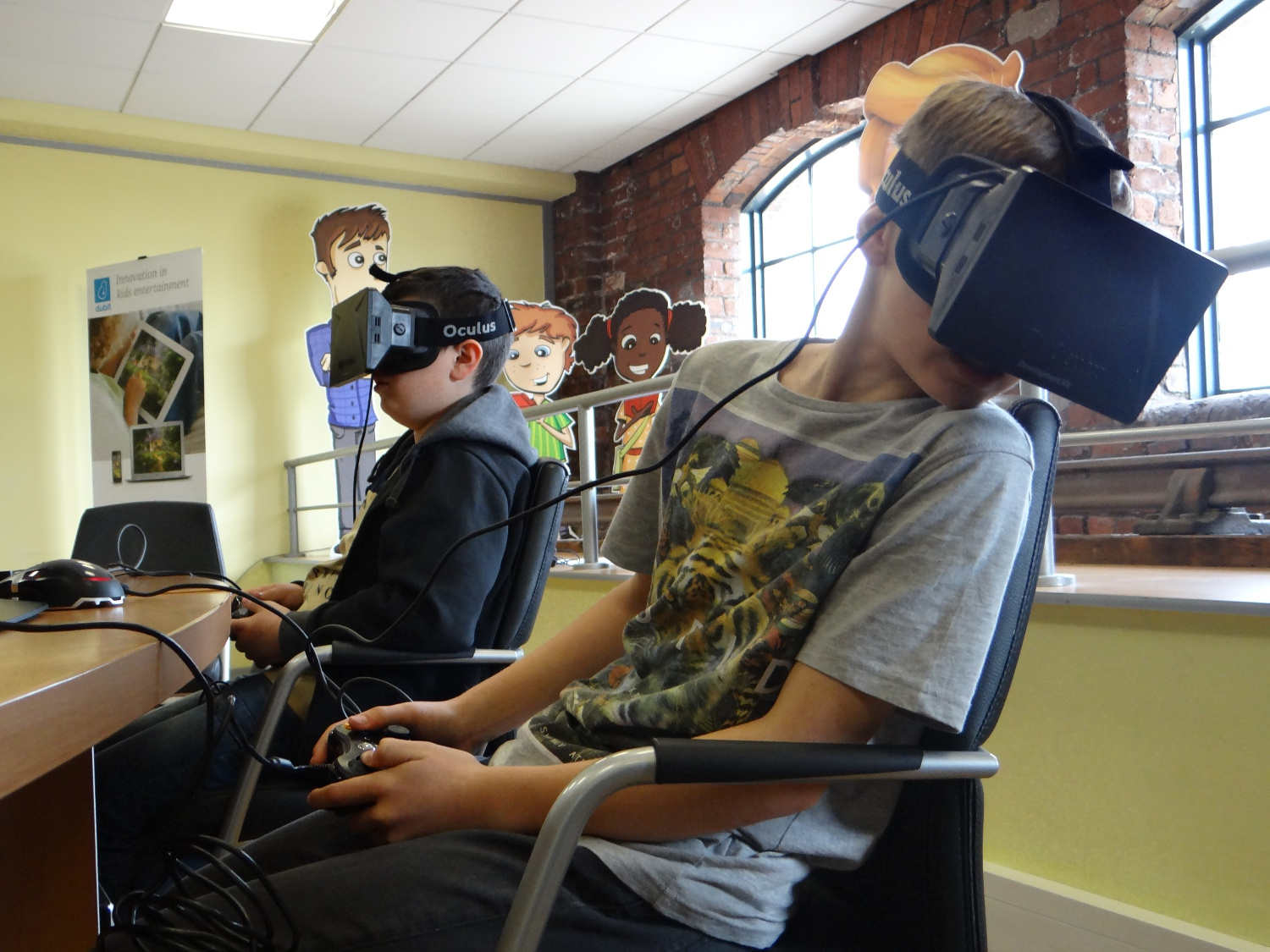 Kids testing out the Oculus Rift.