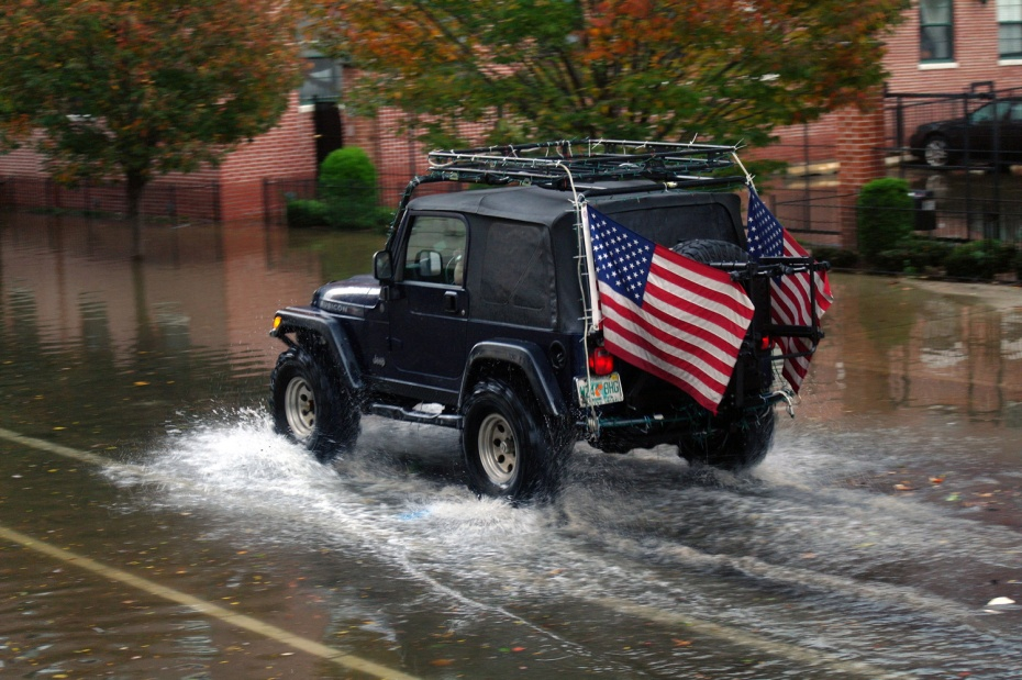 A car drives through the aftermath of Hurricane Sandy in Hoboken, New Jersey.