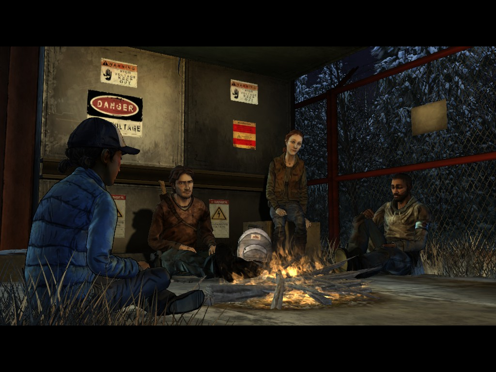 The group shares a quiet moment to trade jokes and stories in The Walking Dead Season Two Episode Five: No Going Back.