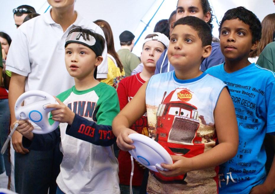 Kids playing Mario Kart