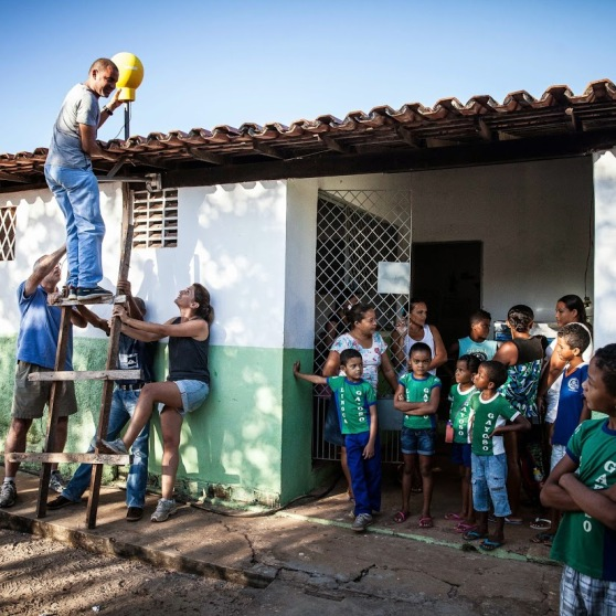 Project Loon team members install a Loon Internet antenna at a school in Brazil.