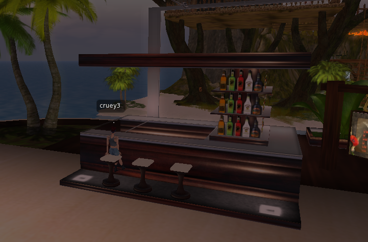 we-soon-got-tired-of-watching-me-make-boxes-and-made-our-way-to-the-third-location-where-judy-likes-to-hang-out-in-second-life-the-clubs-i-took-a-load-off-at-a-nearby-bar