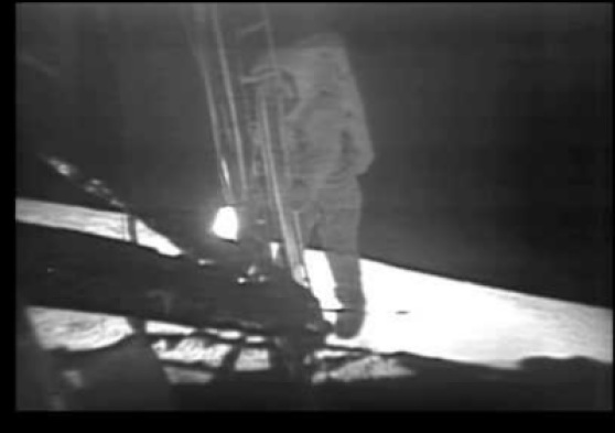 Suspected light source just to the left of the ladder by Aldrin's hand.