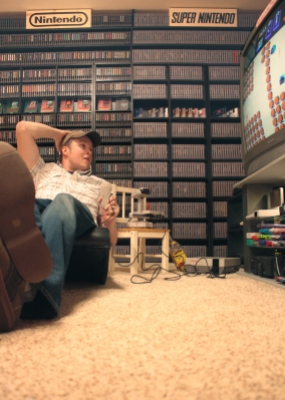 Nintendo Twizer kicking back and enjoying his collection with R.O.B. the Robot.