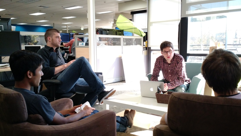 Senior data scientist Mathieu Bastian, second from right, meets with his team of data scientists at company headquarters.