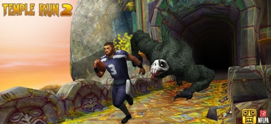 Russell Wilson of the Seattle Seahawks flees the demon monkey in Temple Run 2.