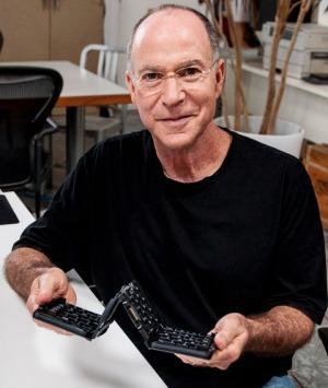 Bob Olodort, the cofounder of Simple Matters, holding the folding Palm keyboard he invented in the early 2000s.