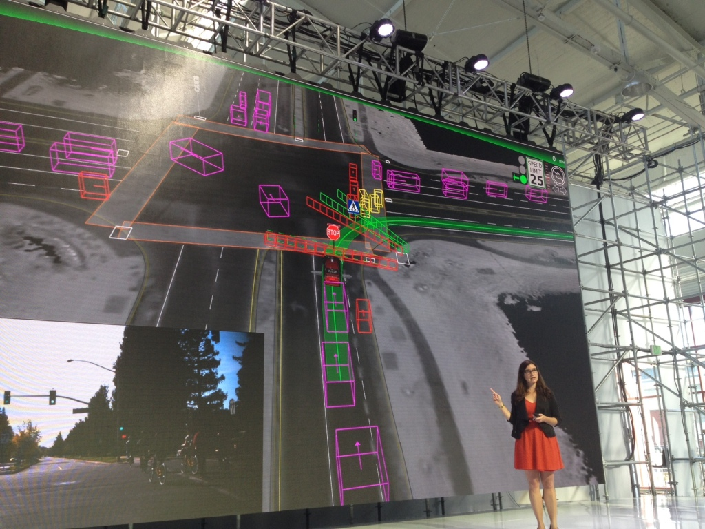 Arden shows how the Google cars brain sees other cars and pedestrians at an intersection.