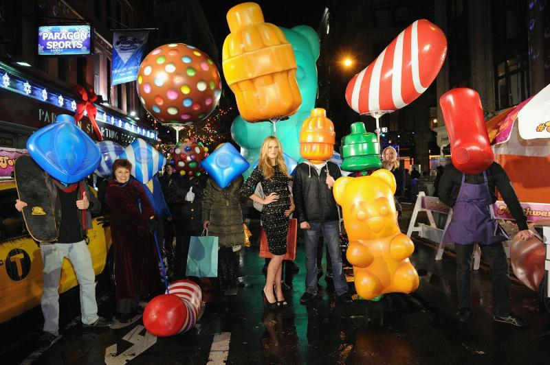 Model and actress Molly Sims helps promote Candy Crush Soda Saga.