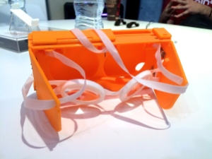 The 3D printed prototype iPhone 6 case with head-straps and suspended aspheric lenses.