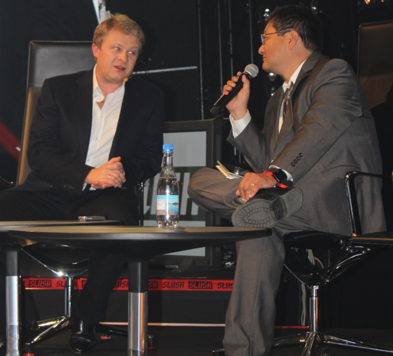 Victor Kislyi (left), CEO of Wargaming.net, on stage with Dean Takahashi at Slush 2014.
