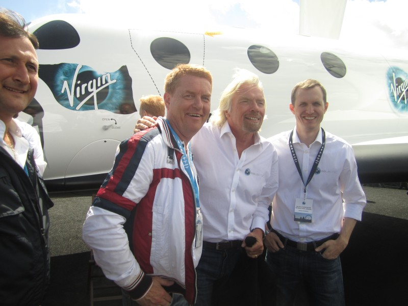 Virgin Galactic customer Gisli Gislason, left, poses for a picture in London with Virgin's Richard Branson (center).