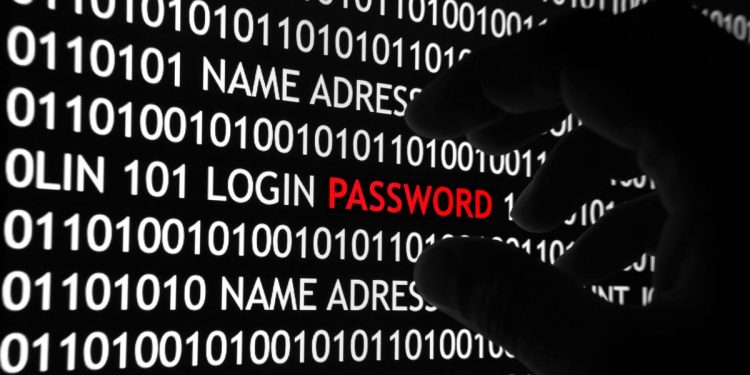 """An image of a hand grabbing the word """"password"""" (written in red) set against a background of binary code."""