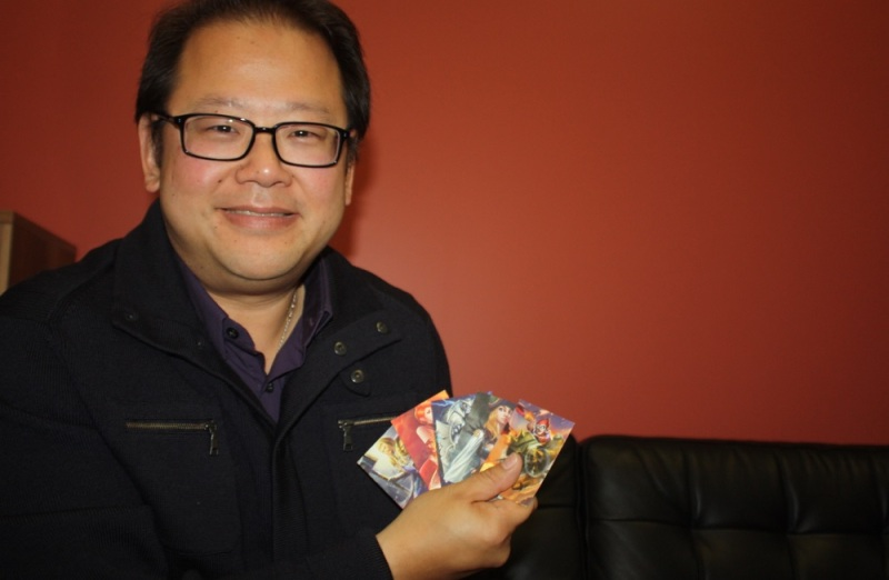 Jim Ngui shows off Heroes Charge cards