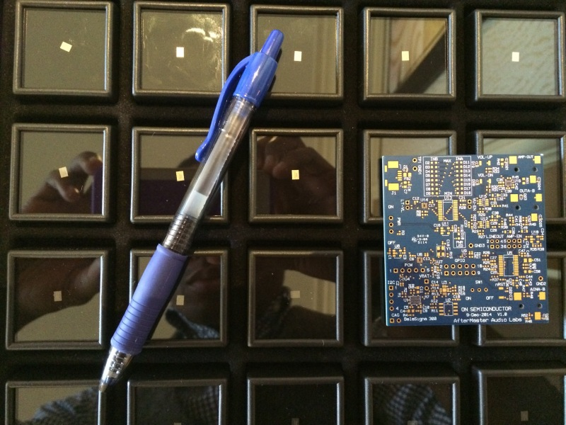 Pen and PCB board provide scale for a case full of AfterMaster's tiny DSP chips.