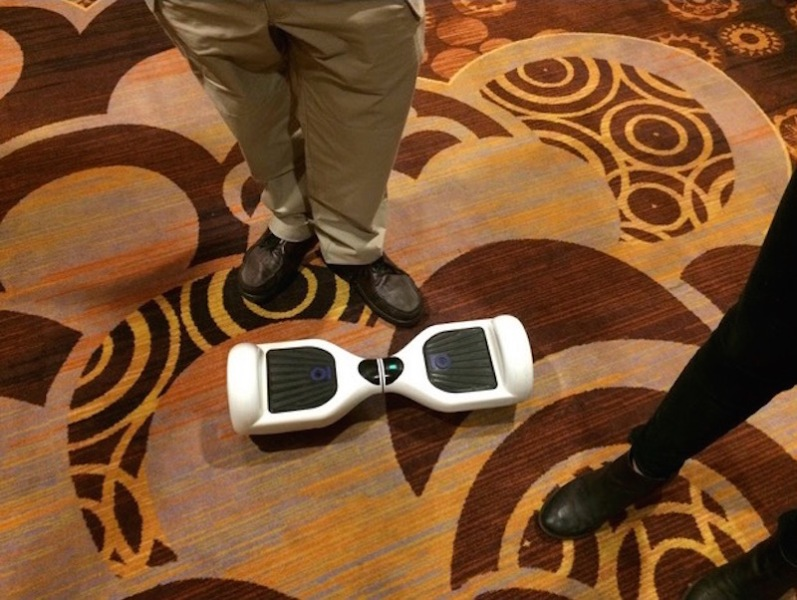 Checking out IO Hawk's Smart Wheels gadget at CES 2015.