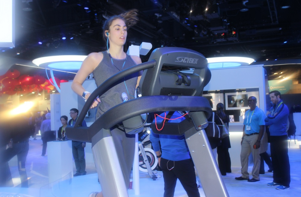 This woman at the Intel CES booth is wearing a Basis Peak smartwatch and SMS headphones. On day one of CES, she ran 11 miles.