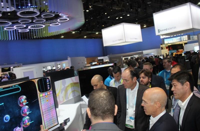 Samsung's North American president Tim Baxter shows Bingo Home to DreamWorks Animaiton chief Jeffrey Katzenberg.