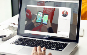 A remote sales rep presenting two smartphones via point-of-view video.