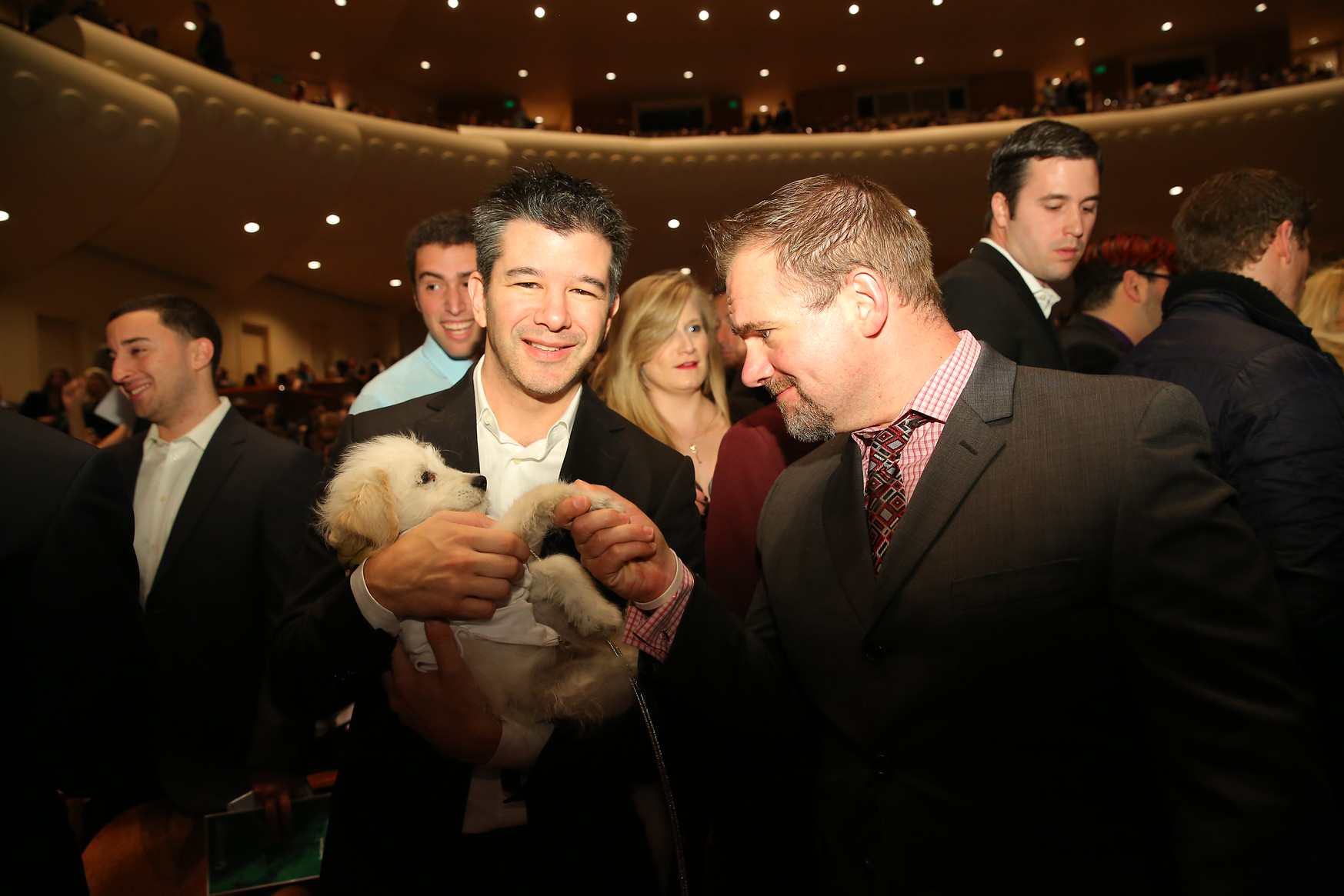 Uber CEO holding his girlfriend's dog after the Crunchies Awards Thursday night.