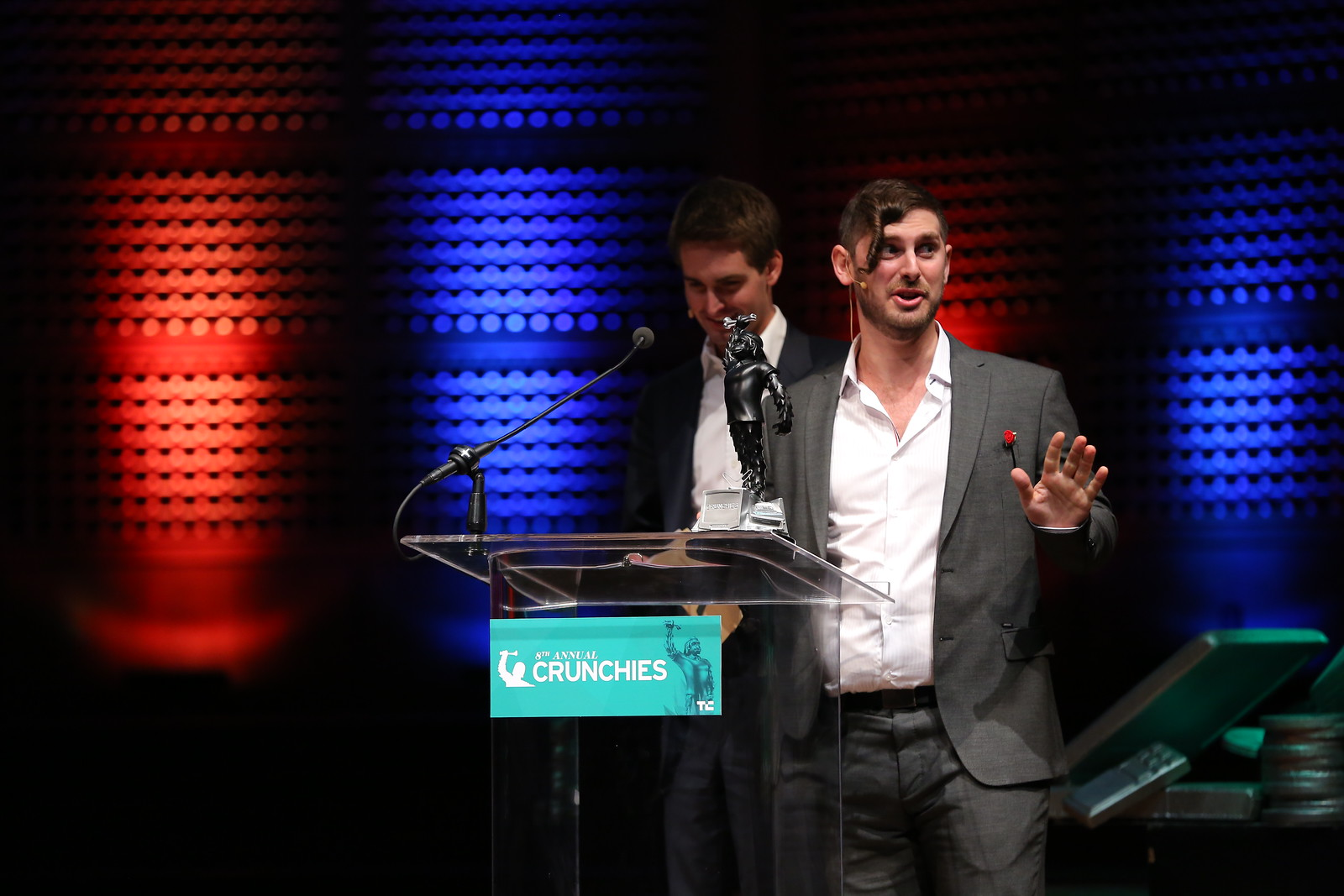 TechCrunch's Josh Constantine and SnapChat CEO Evan Spiegel present an award at the Crunchies.