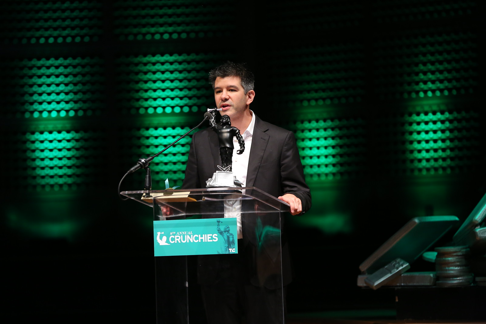 Uber CEO Travis Kalanick accepts the award for Best Overall Startup of 2014.