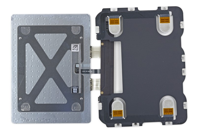 The panel on the left is the piece you touch. It rests on the four pressure sensors in the corners of the panel on the right.