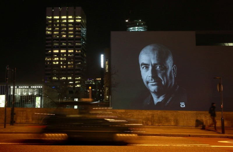 Micky Eales, a London cabbie, is projected onto Waterloo Bridge