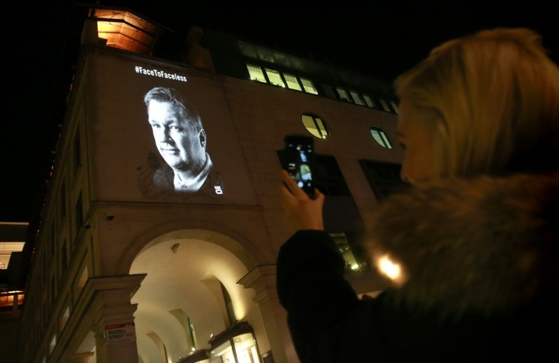 Warren Wolfe, a London cabbie, is projected onto the Royal Opera House