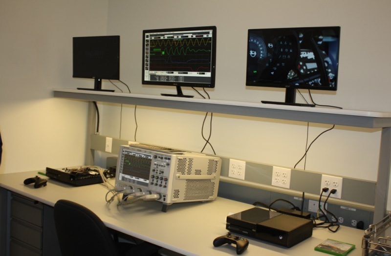 An oscilloscope probes the memory of an Xbox One game console.