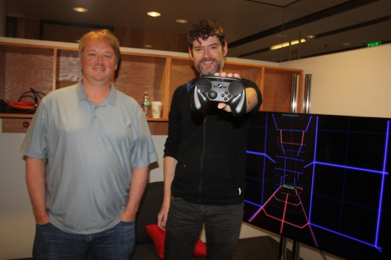 Eric Johnson and Scott Dalton (right) at Valve with a Steam Machine controller.