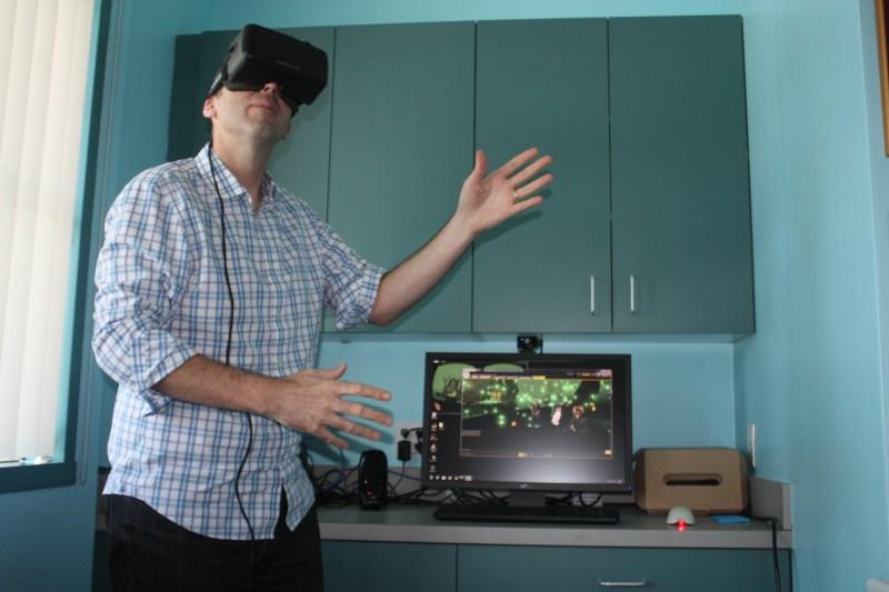 Brett Durrett, chief executive of IMVU, using the Oculus Rift headset.