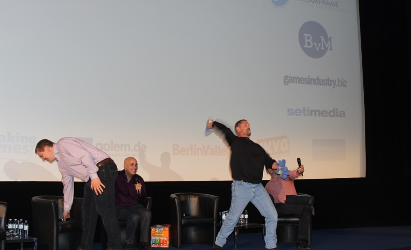 Glen Schofield of Sledgehammer Games tosses Call of Duty T-shirts into the Quo Vadis audience.
