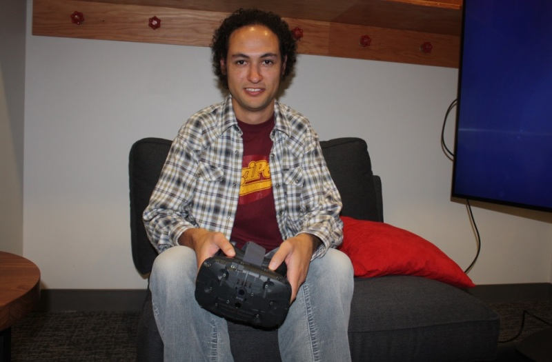 Valve programmer Jeep Barnett with the HTC Vive headset.