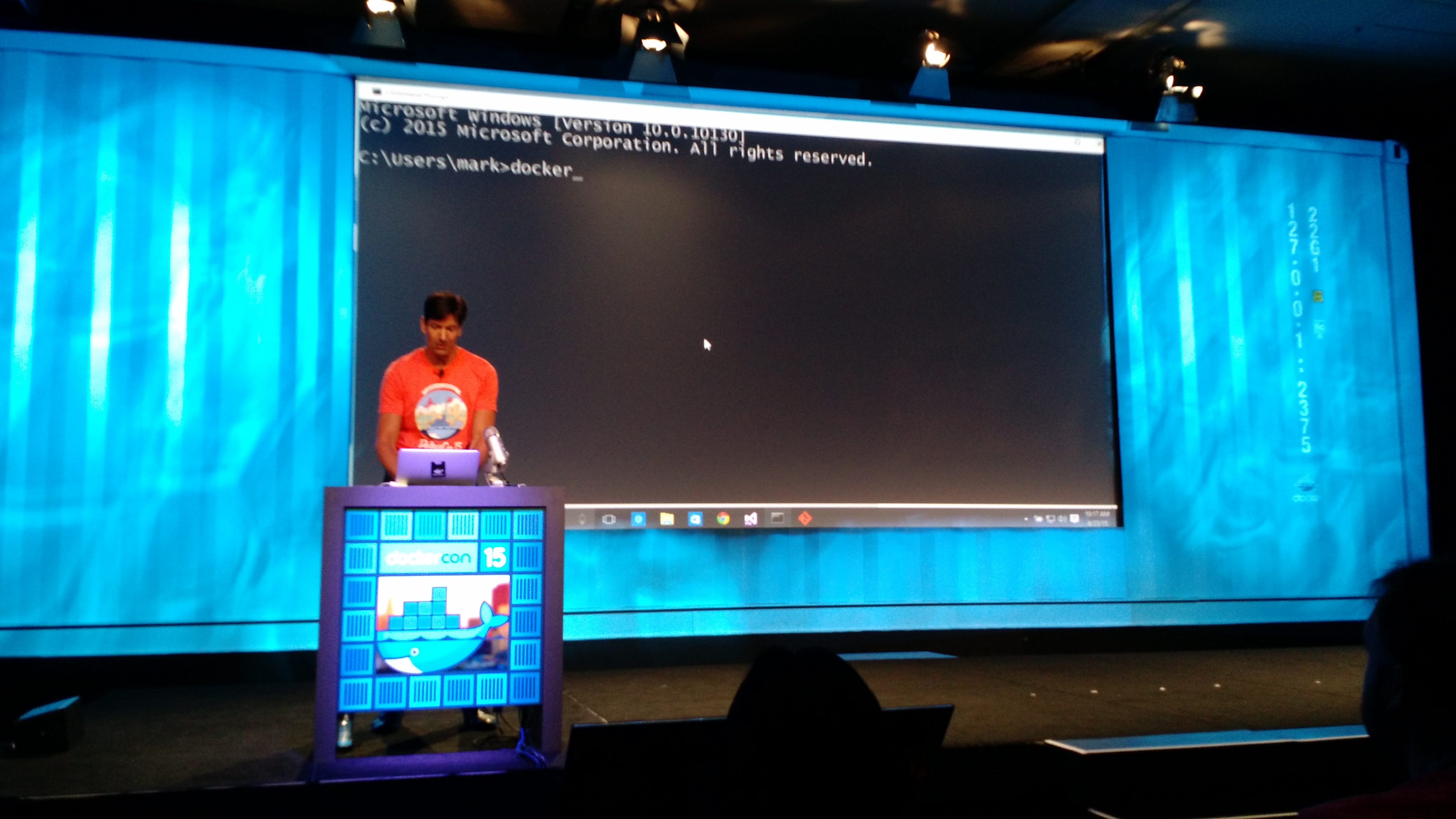 Mark Russinovich uses Docker to build an application that includes some code running in a container on Windows Server and other code running in a container on a Linux server at the DockerCon conference in San Francisco on June 23.