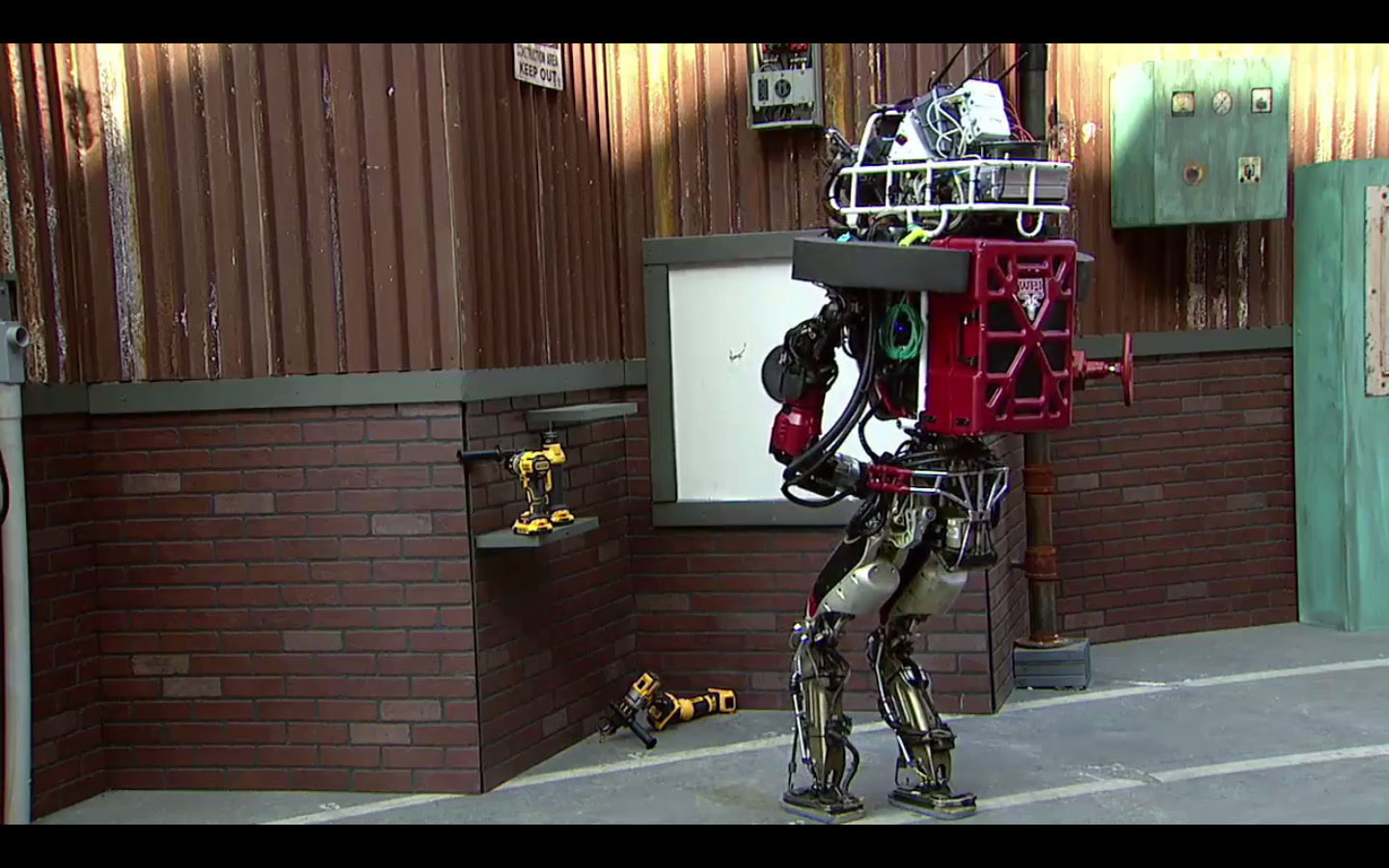 The WPI-CMU Warner ATLAS robot drops the drill it was going to use to make a hole in a wall at the 2015 DARPA Robotics Challenge in Pomona, Calif., on June 6.