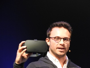 Brendan Iribe with the final consumer version of the Oculus Rift virtual-reality headset.