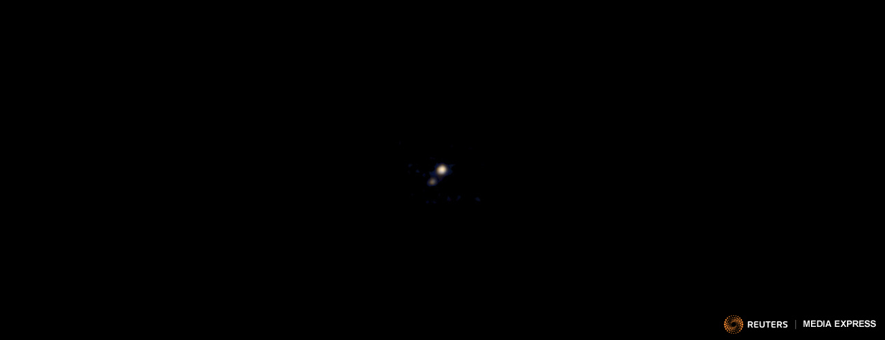 Pluto and its largest moon, Charon, taken by the Ralph color imager aboard NASA's New Horizons spacecraft, April 9, 2015.  REUTERS/NASA/Johns Hopkins University Applied Physics Laboratory/Southwest Research Institute/Handout
